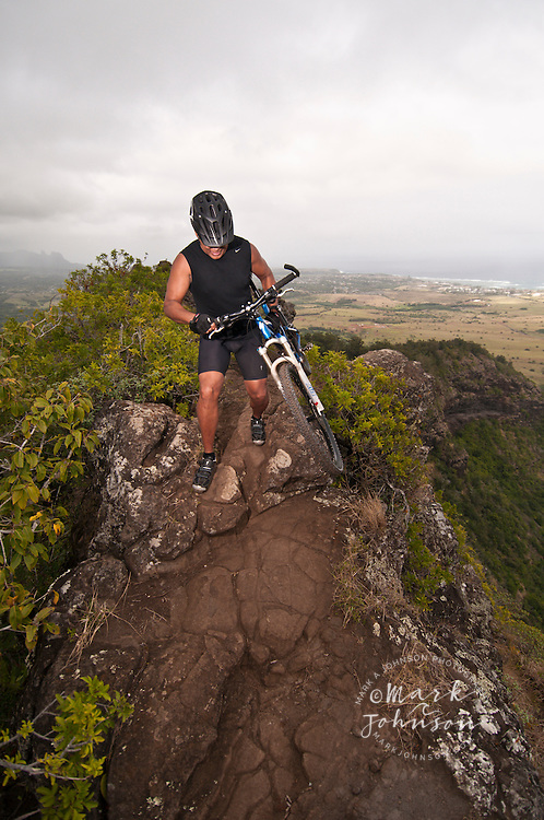 Mountain biking on Mt. Nonou (Sleeping Giant), Kauai, Hawaii