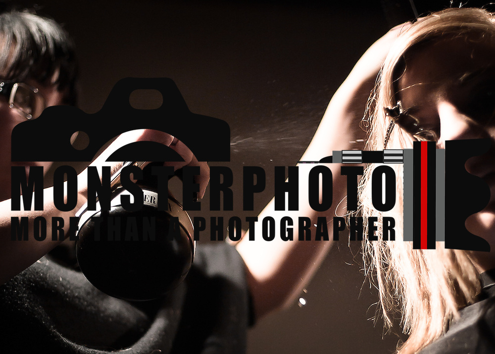 02/12/12 West Chester PA: Hairstylist Jessica Bradney from Precision Barbershop in Warminster, PA working on an unknown model hair during Open Chair 11 Sunday, Feb. 12, 2012 at The Note in West Chester Pennsylvania.<br /> <br /> Special to Monsterphoto/SAQUAN STIMPSON