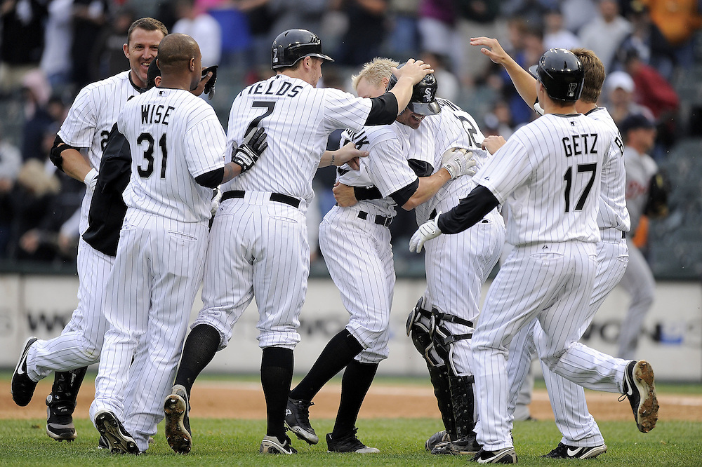 CHICAGO - JUNE 11:  Scott Podsednik #22 of the Chicago White Sox is mobbed by teammates Josh Fields #7, Chris Getz #17 and others after hitting a game winning single in the ninth inning against the Detroit Tigers on June 11, 2009 at U.S. Cellular Field in Chicago, Illinois.  The White Sox defeated the Tigers 4-3. (Photo by Ron Vesely)