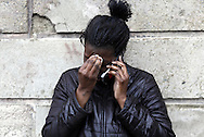 "Shameeka Burks (24) cries as she talks on a cellular telephone near the intersection of Benkard Ave. and Little Monument Street in the City of Newburgh, NY on Saturday morning, March 13, 2010. Her boyfriend, John ""Tarzan"" Maldonado (21) was shot and killed at the scene on Friday night."