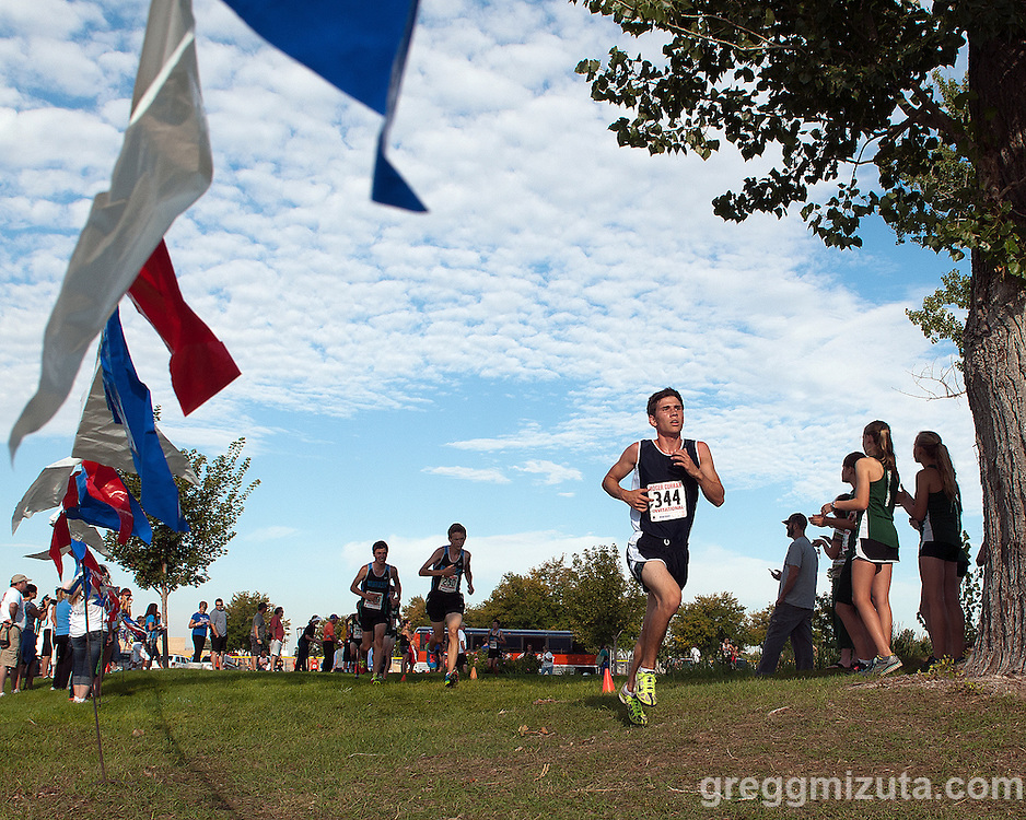 Skyview senior Zach Davlin on the second loop of the Roger Curran 5k varsity race at West Park in Nampa, Idaho on September 14, 2013. Davlin finished fourteenth with a time of 18:13.66.