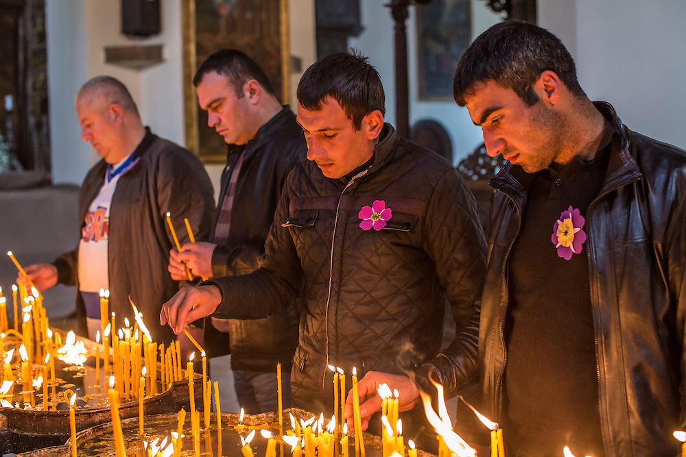 VAGHARSHAPAT, ARMENIA - APRIL 23: Men light prayer candles inside Etchmiadzin Cathedral, which is the mother church of the Armenian Apostolic Church and is considered the oldest cathedral in the world, before a canonization ceremony for victims of the Armenian genocide on April 23, 2015 in Vagharshapat, Armenia. Tomorrow will mark the one hundredth anniversary of events generally considered to be the start of a campaign of genocide against minority ethnic Armenians living in present-day eastern Turkey by the Ottoman government over fears of their allegiance during World War I. (Photo by Brendan Hoffman/Getty Images) *** Local Caption ***