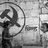 Two sisters play in a Maoist controlled area.