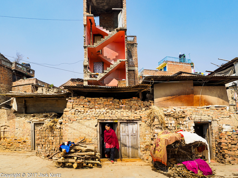 01 MARCH 2017 - BUNGAMATI, NEPAL: An exterior wall fell off this home in Bungamati during the 2015 earthquake. The home is not usable. Recovery seems to have barely begun nearly two years after the earthquake of 25 April 2015 that devastated Nepal. In some villages in the Kathmandu valley workers are working by hand to remove ruble and dig out destroyed buildings. About 9,000 people were killed and another 22,000 injured by the earthquake. The epicenter of the earthquake was east of the Gorka district.     PHOTO BY JACK KURTZ