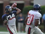 Ole Miss' Brandon Bolden (34) throws during a team scrimmage at Vaught-Hemingway Stadium in Oxford, Miss. on Saturday, August 20, 2011.