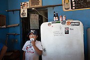 Miguel Valdez, Jr. hangs out while his father tends bar at the Park Bar in Boquillas del Carmen on May 14, 2014.