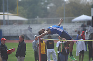 Oxford High's Robert Vaughn high jumps at the Oxford Eagle Invitational at Oxford High School in Oxford, Miss. on Monday, March 28, 2011.