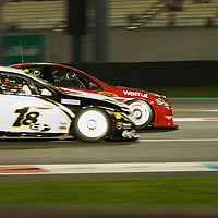 james moffat (dick jonhson racing)  car passing competitor during YAS V8 400  in yas marina circuit, abu dhabi UAE.11 february 2011..winners Jamie Whincup - team vodaphone (1), Alex davidson - irwin racing (2), makr winterbottom - orrcon steel fpr falcon (3)...real action heroes event..Providing the action for the main event are the Australian V8 Supercars, a two-car series of makers Holden and Ford - a close rivalry that runs deep in Australian culture. This season, that rivalry is heightened by the switch of 2010 series Champion James Courtney, who drives with the coveted No.1 plate, from his winning 2010 Ford Falcon to the Holden Commodore for 2011.