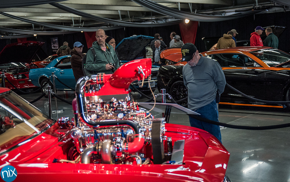 Car enthusiast browse displays at the Charlotte AutoFair at Charlotte Motor Speedway Thursday morning.