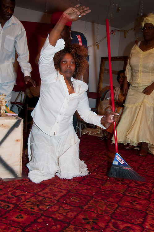 Vodou ceremony during the winter solstice in a suburbs of Montreal. Woman possessed by Klermezin, feminin spirit who bring light for people that need to take decision