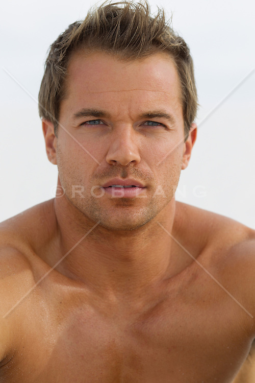 All American shirtless man with blue eyes and brown hair