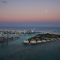 Fisher Island, Miami and Government Cut aerial at sunset with the moon rising, looking east
