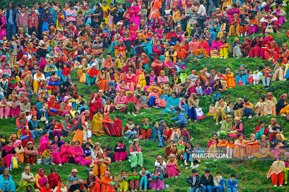 Local people of Himachal watching a wrestling match, locally known as Chhenj, in a village in Himachal