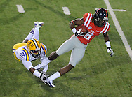 Mississippi wide receiver Terrell Grant (8) is tackled by LSU's Kwon Alexander (25) at Vaught-Hemingway Stadium in Oxford, Miss. on Saturday, October 19, 2013. (AP Photo/Oxford Eagle, Bruce Newman)