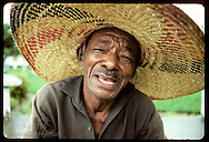 Man in large straw hat talks about his work as town gardener in Eirunepe, Amazonas. Brazil