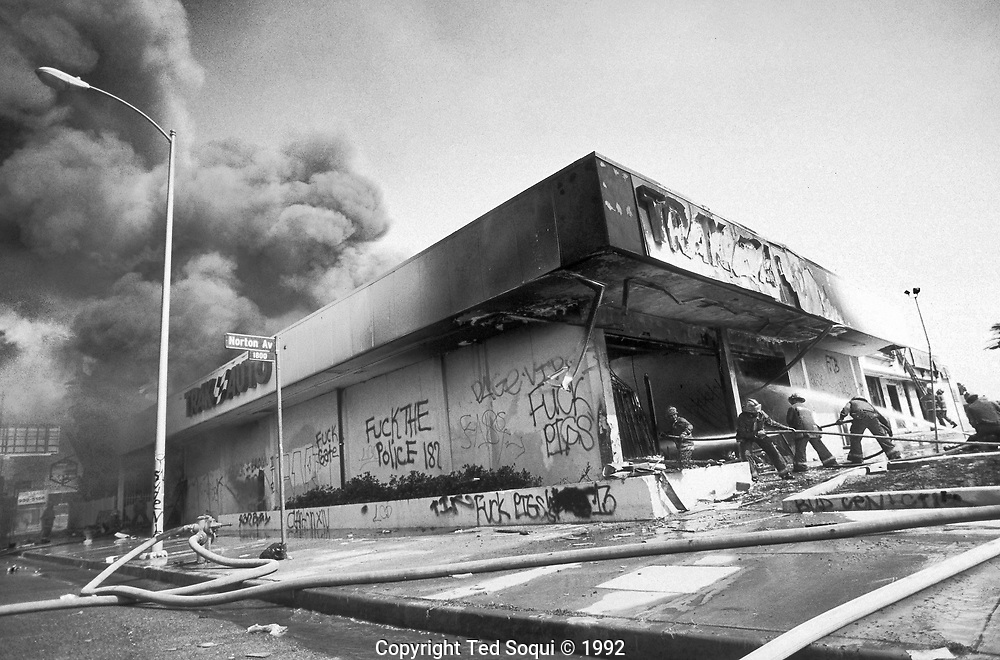 A Trak Auto Parts store is looted and burned on W.Washington Blvd. near Norton Ave.<br /> <br /> 25 before and after LA92 photo project.