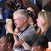 Family and friends take photos from the stands during Delcastle high school commencement exercises Tuesday, May 26, 2015, at The Bob Carpenter Sports Convocation Center in Newark, Delaware