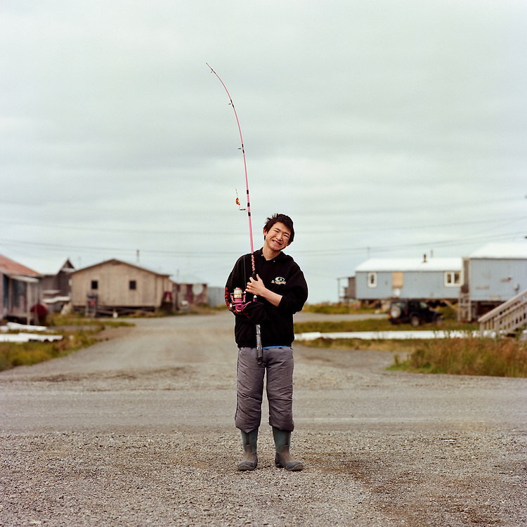 """""""I am 16. I love basketball and soccer. I have two years left of high school. I just want to graduate—after that I am undecided. I was just fishing for red salmon (sockeye) and king (chinook) salmon; my favorite is red salmon. """"—Moses Guest is Yupik from Quinhagak, Alaska. For some locals here, the fall season means enjoying the taste of aged, spawning sockeye salmon. They are called sayallret in Yupik. They turn from a silvery grey to bright red bodies with green heads. Male sockeye grow a large hooked beak and a lump on their backs and are preferred for harvesting. Sayallret can be eaten in a number of ways; boiled and dipped in seal oil, half-dried with seal oil, or dried and smoked with seal oil."""