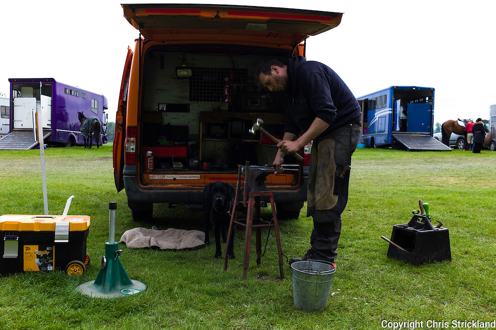 Floors Castle, Kelso, Roxburghshire, UK. 15th May 2015. A farrier at work during the Floors Castle International Horse Trials.