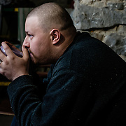 15 of April 2015 / Petrovski/ Donetsk Oblast/ Ukraine - Anton, 30 years old. No work and can't join the separatist army as he wish because of its legs got injured after a severe car accident several years ago. So he spend the days either inside the bunker or visiting is house in Petrovsky and taking care of his little garden.