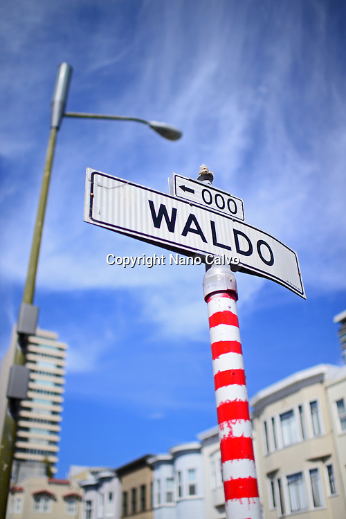 Waldo street sign painted with red stripes in San Francisco, California.