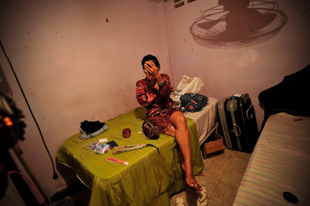 A prostitute gets ready doing their hair and makeup in a brothel in Cartagena, Colombia. A sex scandal erupted recently when secret service agents were found bringing prostitutes to their hotel rooms while in Cartagena preparing for President Barack Obama's arrival to the Summit of the Americas.