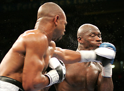 Roy Jones Jr.(l) and Antonio Tarver (r) trade punches during their third fight for the World Light Heavyweight Championship at the St. Pete Times Arena in Tampa, FL.