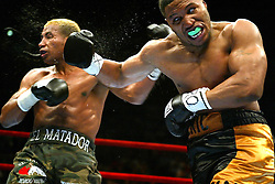April 17, 2004; New York, NY; Ricardo Mayorga takes a right hand to the head from Eric Mitchell during their 10 round bout at Madison Square Garden.  Mayorga won a unanimous decision.