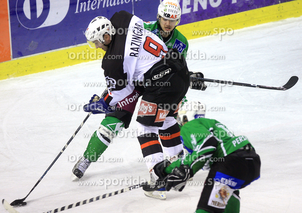 Tomaz Razingar vs Igor Cvetek at 39th Round of EBEL League ice hockey match between HDD Tilia Olimpija and HK Acroni Jesenice, on December 30, 2008, in Arena Tivoli, Ljubljana, Slovenia. Tilia Olimpija won 4:3. (Photo by Vid Ponikvar / SportIda).