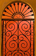 Arched window and wrought iron grill at Domitila Restaurant in Old Town Mazatlan, Mexico.