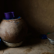 An earthernware pot used to store water is seen in the room Rihanata Ouedraogo shares with her mother, Zalissa Rabo, in Koala, Burkina Faso on 27 February 2014. In the absence of an accessible improved water source, community members rely on a dam which is also used by animals, and a small number of shallow, hand-dug, low-yield wells.