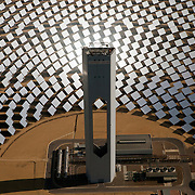 The PS20 solar tower plant sits at Sanlucar la Mayor outside Seville, Spain. The solar tower plant, the first commercial solar tower in the world, by the Spanish company Solucar (Abengoa), can provide electricity for up to 6,000 homes. Solucar (Abengoa) plans to build a total of 9 solar towers over the next 7 years to provide electricity for an estimated 180,000 homes.