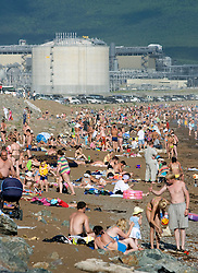 Busy beach at Prigorodnoye near Korsakov on Sakhalin Island with LNG tanks built by Shell 2008