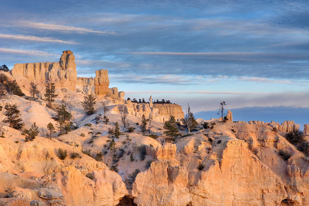 Setting sun on cliffs of Bryce Canyon from Paria View, Bryce Canyon National Park Utah