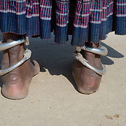 The feet of a mature Rajasthani woman near Jodhpur, wearing traditional anklets, jewelry (India)