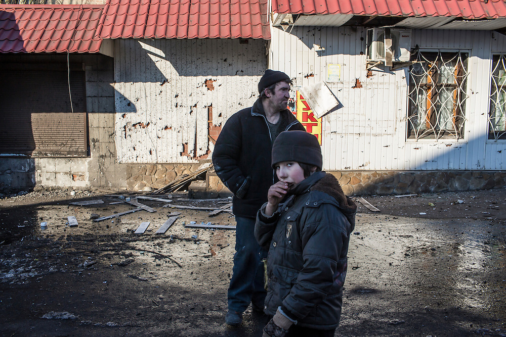 DEBALTSEVE, UKRAINE - FEBRUARY 20: Local residents in the heavily damaged town center on February 20, 2015 in Debaltseve, Ukraine. Ukrainian forces withdrew from the strategic and hard-fought town after being effectively surrounded by pro-Russian rebels, though fighting has caused widespread destruction. (Photo by Brendan Hoffman/Getty Images) *** Local Caption ***