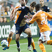 Union Attacker Veljko Paunovic #16 (middle) try to keep possession of the ball while Dynamo Midfielder Adam Moffat #16 grabs him from behind during Saturday MLS regular season match. The Dynamo and The Philadelphia Union played to a 1-1 tie. Saturday Aug. 6, 2011. at PPL Park in Chester PA...The News Journal/SAQUAN STIMPSON