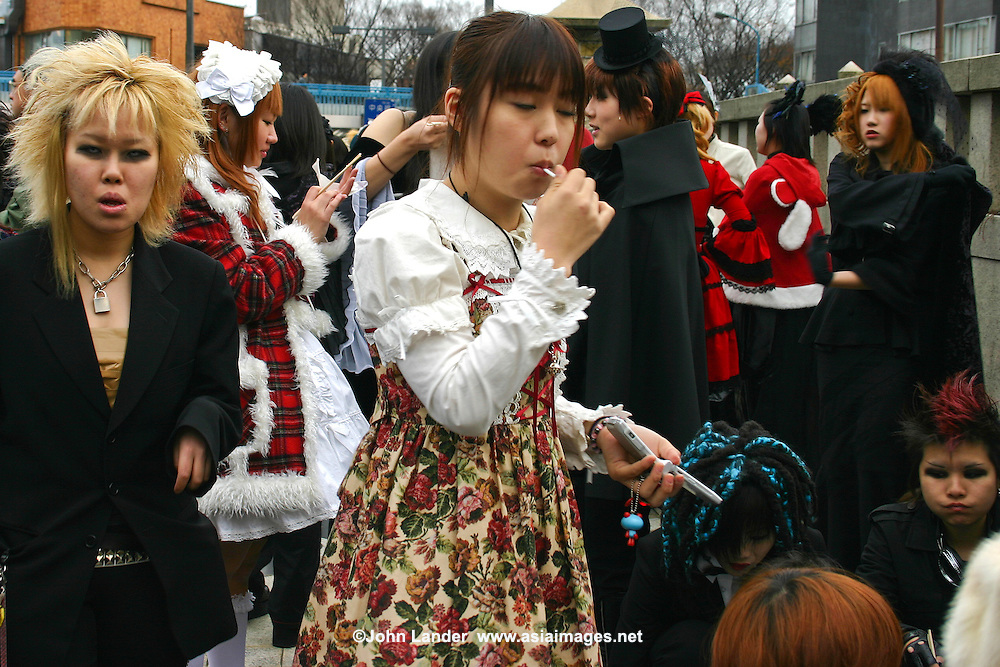 "Costume Play Punks Harajuku - A wide variety of ""costume play"" getups are shown here: goths, cartoon characters from Japanese manga, anime,  the sweet-and-innocent frilly look or combinations in between (goth lolly)  Every Sunday, these cosplay characters converge on Harajuku, Tokyo's fashion quarter. Most casual observers say that cosplay is a reaction to the rigid rules of Japanese society. But since so many cosplay girls congregate in Harajuku and Aoyama - Tokyo headquarters of Fendi, Hanae Mori and Issey Miyake, others consider it is a reaction to high fashion. Whatever the cause, cosplay aficionados put a tremendous amount of effort into their costumes every Sunday. One wonders what they wear on Monday morning..."
