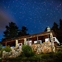 The North Star shines above the William Allen White Cabin in Rocky Mountain National Park, Colorado.