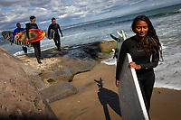 Santa Cruz, California: India's first female professional surfer Ishita Malaviya spends an afternoon surfing with her partner Tushar Pathiyan (far left) and local surfers. Ishita and Tushar founded the Shaka Surf Club in Manipal, India.