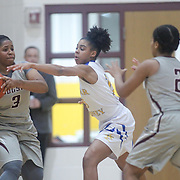 Caesar Rodney Kylie Kornegay (15) defends Hodgson Vo-Tech Guard Kayla Braxton-Young (3) during a Diamond State Classic game Wed. Dec. 28, 2016 at Saint Elizabeth's High School in Wilmington.