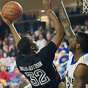 12/30/11 Newark DE: Temple Junior Forward #32 Rahlir Hollis-Jefferson shoot over Delaware Senior Forward #23 Hakim McCullar during a NCAA basketball game against Delaware Friday, Dec. 30, 2011 at the Bob carpenter center in Newark Delaware...Rahlir Jefferson-Hollis led the Owls with 13 points and eight rebounds, Anthony Lee added a career-high 12 points, seven rebounds, and three blocks, Juan Fernandez contributed 11 points, and Ramone Moore chipped in with 10 points and a game-high six assists.