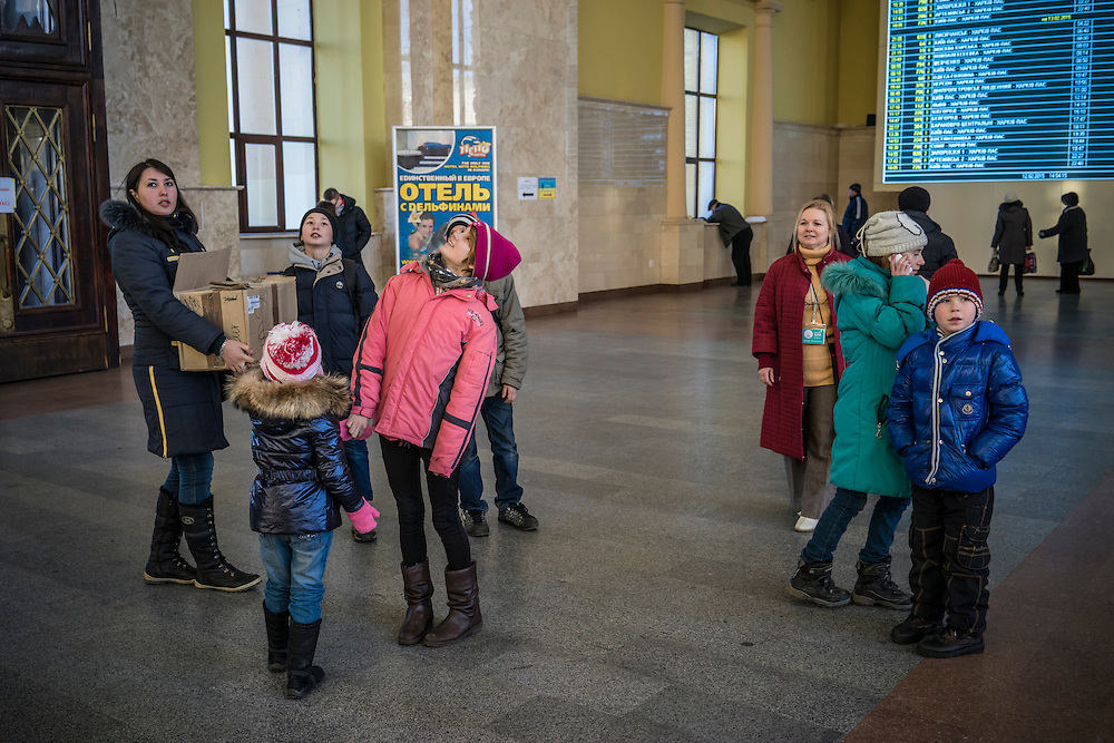 Children displaced by fighting around the town of Debaltseve look around at the train station where they've arrived on Thursday, February 12, 2015 in Kharkiv, Ukraine. The group spent several hours in Kharkiv before boarding a train that will take them to Lviv, on the Western side of the country.
