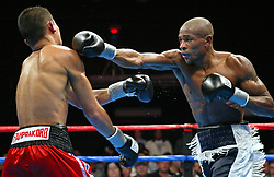 Valdemir Pereira (r) and Phafrakorb Rakkietgym (l) trade punches during their 12 round IBF Featherweight title fight at the Foxwoods Hotel and Casino.  Pereira captured the vacant title with a unanimous decision win