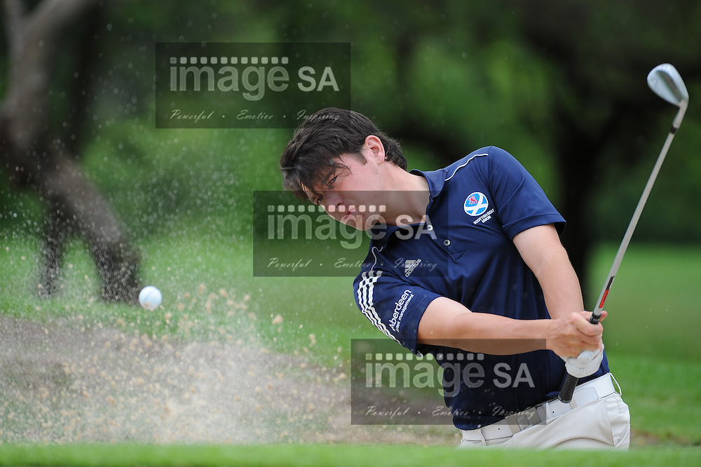 MALELANE, SOUTH AFRICA - Tuesday 17 February 2015, Ewen Ferguson of Scotland plays out of the bunker  during the practise round of the annual Leopard Trophy, a 2 day test between teams of the South African Golf Association and the ScottishGolf Union, at the Leopard Creek Golf Estate.<br /> Photo Roger Sedres/ Image SA