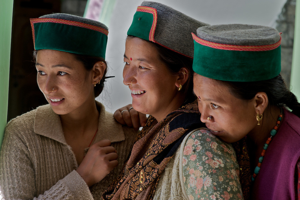Three Kinnauri women gather and play as they wait in line at a medical clinic in the village of Giabong, Himachal Pradesh