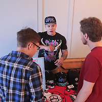 R.J. Wilson, center of L3VEL NATION Clothing talks to Jeremy Bertarioni, left, and Clay Hamerski during Sneaker Jam Sunday July 20, 2014 at Carolina Club 1880 in Wilmington, N.C. The event offered sneaker collectors the opportunity to purchase and trade new and rare shoes. (Jason A. Frizzelle)