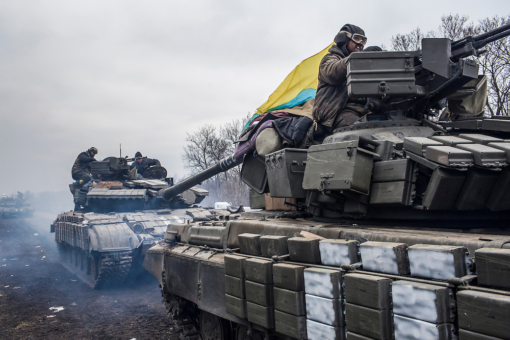 ARTEMIVSK, UKRAINE - FEBRUARY 19: Ukrainian soldiers drive tanks along the road leading out of Debaltseve on February 19, 2015 in Artemivsk, Ukraine. Ukrainian forces have begun withdrawing from the strategic and hard-fought town of Debaltseve after being effectively surrounded by pro-Russian rebels. (Photo by Brendan Hoffman/Getty Images) *** Local Caption ***