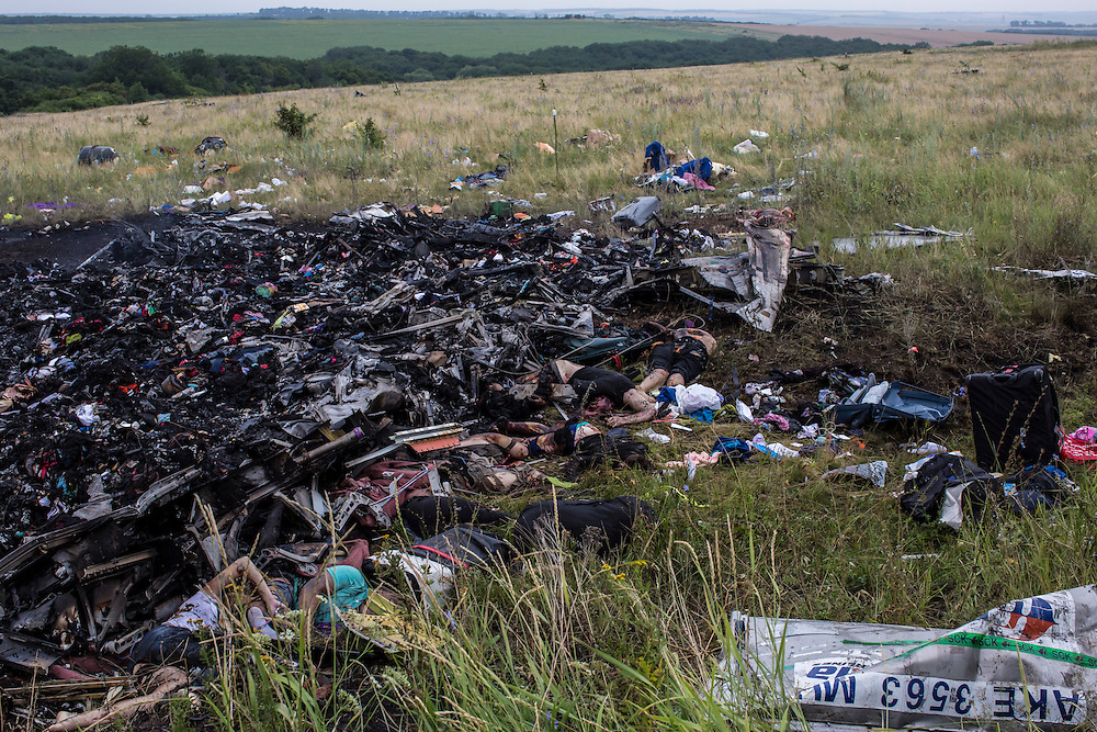 GRABOVO, UKRAINE - JULY 18: The bodies of victims of the crash of Malaysia Airlines flight MH17 lie among burned wreckage in a field on July 18, 2014 in Grabovo, Ukraine. Air Malaysia flight MH17 travelling from Amsterdam to Kuala Lumpur has crashed on the Ukraine/Russia border near the town of Shaktersk. The Boeing 777 was carrying 280 passengers and 15 crew members. (Photo by Brendan Hoffman/Getty Images) *** Local Caption ***