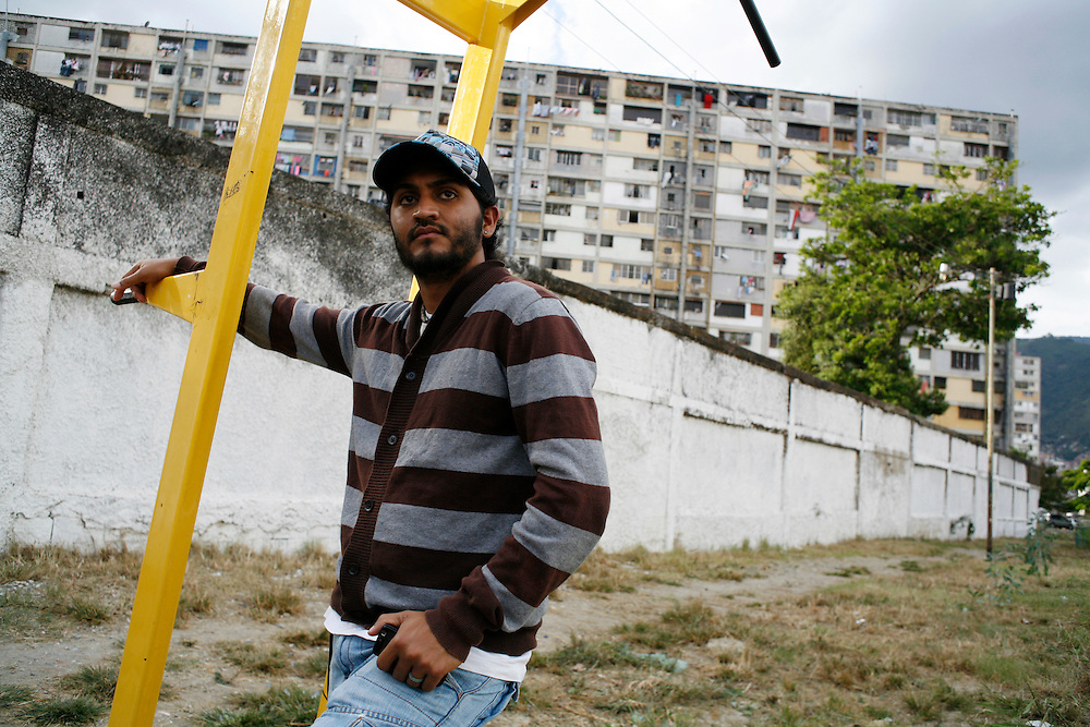 A member of the Alexis Vive collective in the 23 de Enero barrio stands by a workout machine provided to the community by the group. Opposition groups have accused such collectives in the barrios of militancy, but collectives claim they exist to organize communities on a micro level.